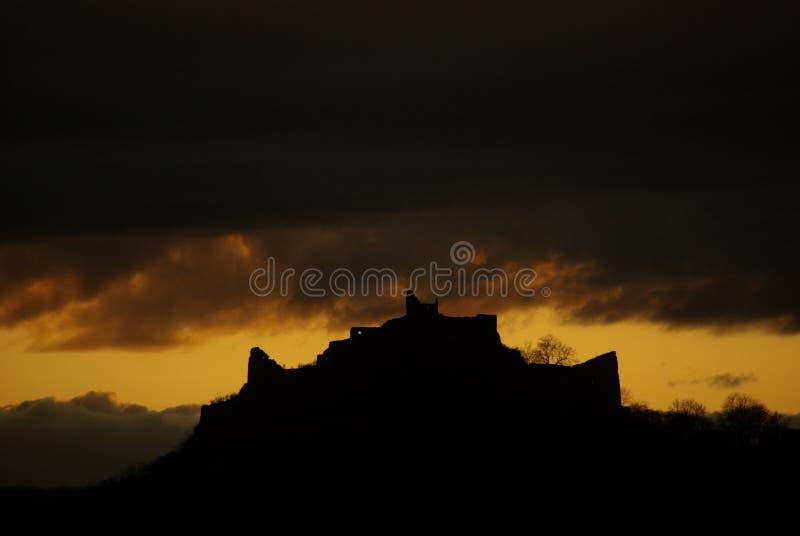 Castillo en puesta del sol imágenes de archivo libres de regalías