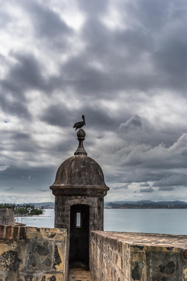 Castillo San Felipe del Morro tower with pelican on top. Angry stormy sky in San Juan Puerto Rico stock images