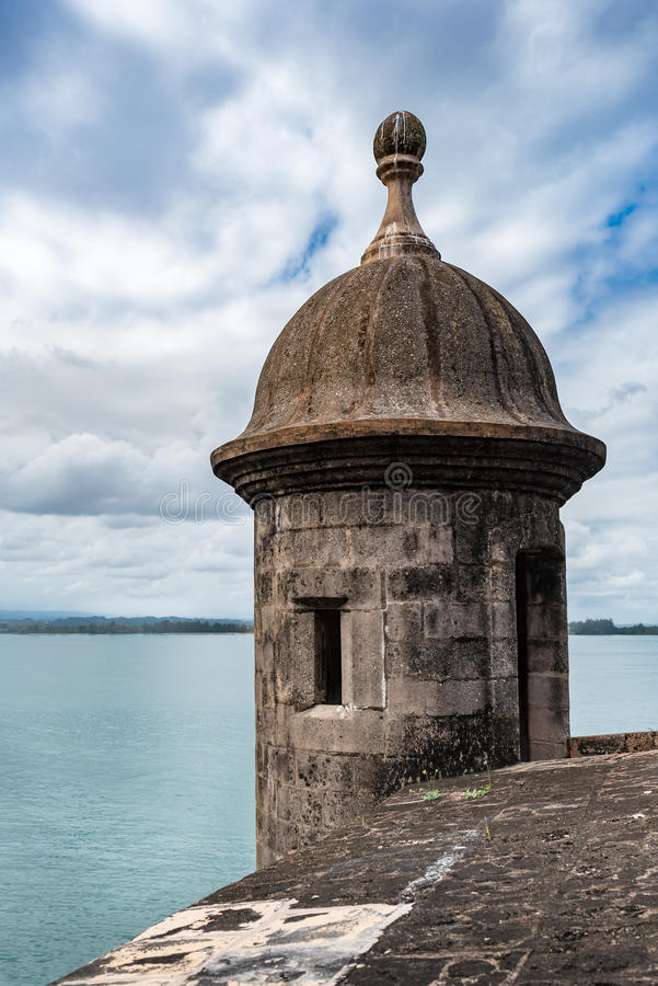Castillo San Felipe del Morro tower turret. With cloudy sky and aqua water in San Juan Puerto Rico royalty free stock photography