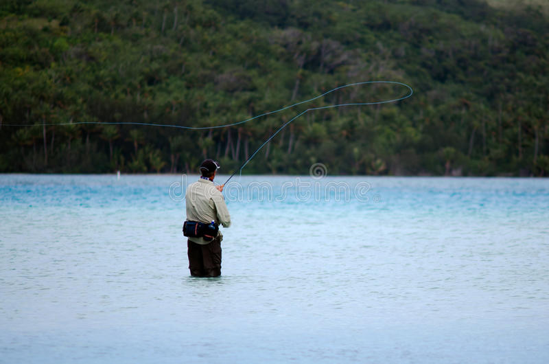 Casting for bonefish in Aitutaki Lagoon Cook Islands royalty free stock photography