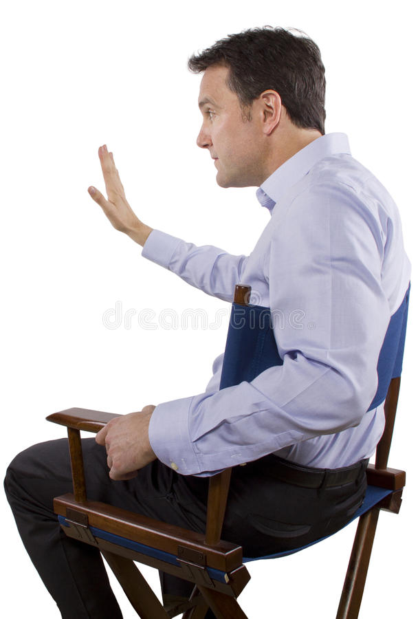 Casting Director. Male casting director sitting on a folding chair stock images