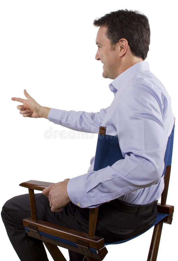 Casting Director. Male casting director sitting on a folding chair royalty free stock photography