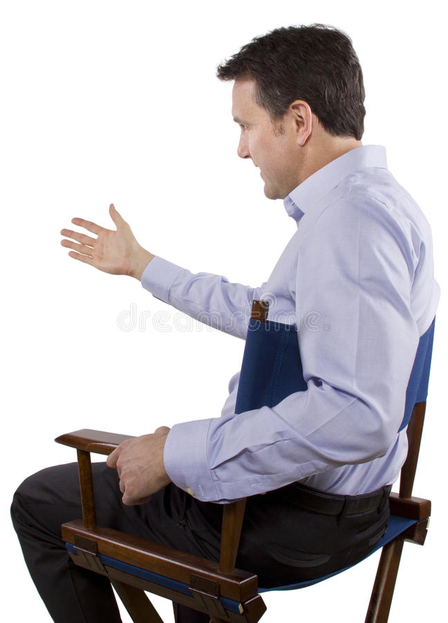 Casting Director. Male casting director sitting on a folding chair stock photography
