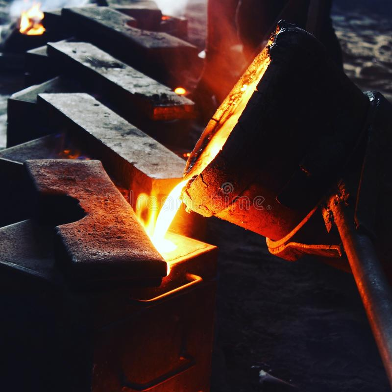 Casting. Live Pic of pouring metal in casting industry stock photography