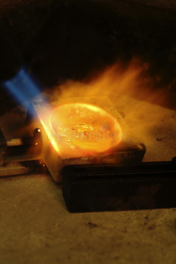 Gold in fusion for ingots with live flames stock photos