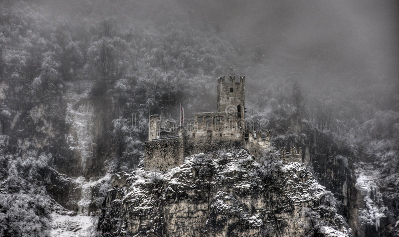 Castle. Decayed castle with clouds and snow royalty free stock image