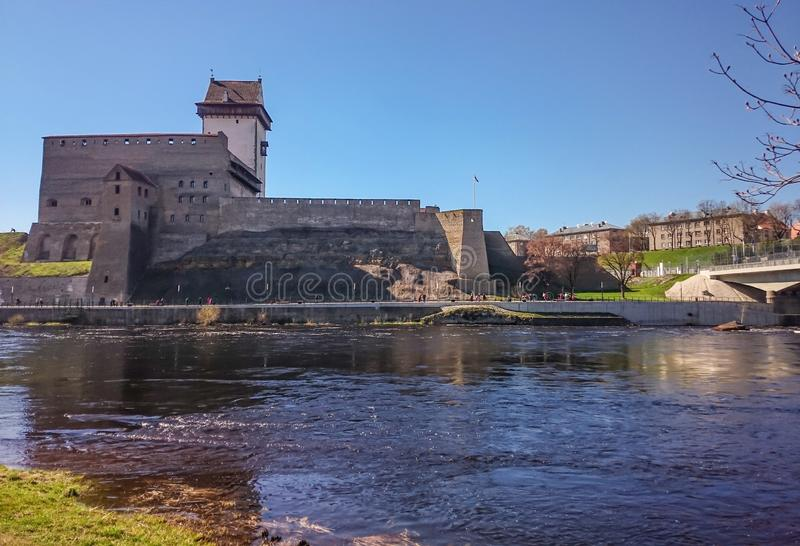 The castle on the banks of the river close-up royalty free stock photo