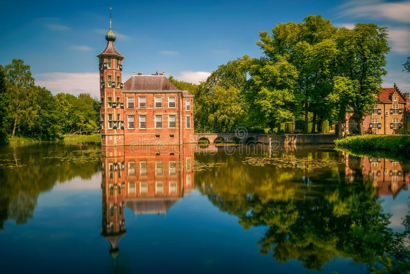 Castle Bouvigne and the surrounding park in Breda, Netherlands. Castle Bouvigne and the surrounding park with reflection in water situated near the Dutch city of royalty free stock image