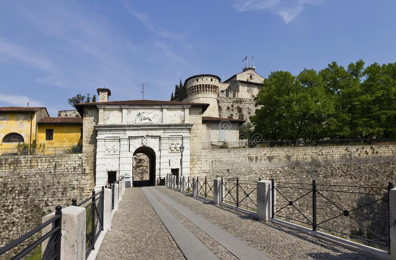 Castle of Brescia is the medieval castle complex on top of Cidneo Hill. Drawbridge with the Venetian lion carved in stone of Brescia castle stock photo