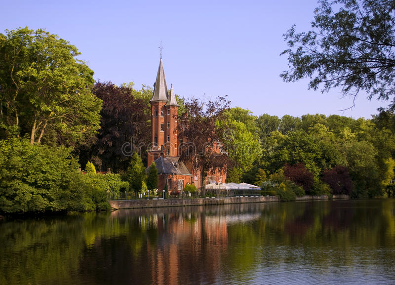 Castle in Brugge. View on a channel in Brugge / Bruges, Belgium royalty free stock photography
