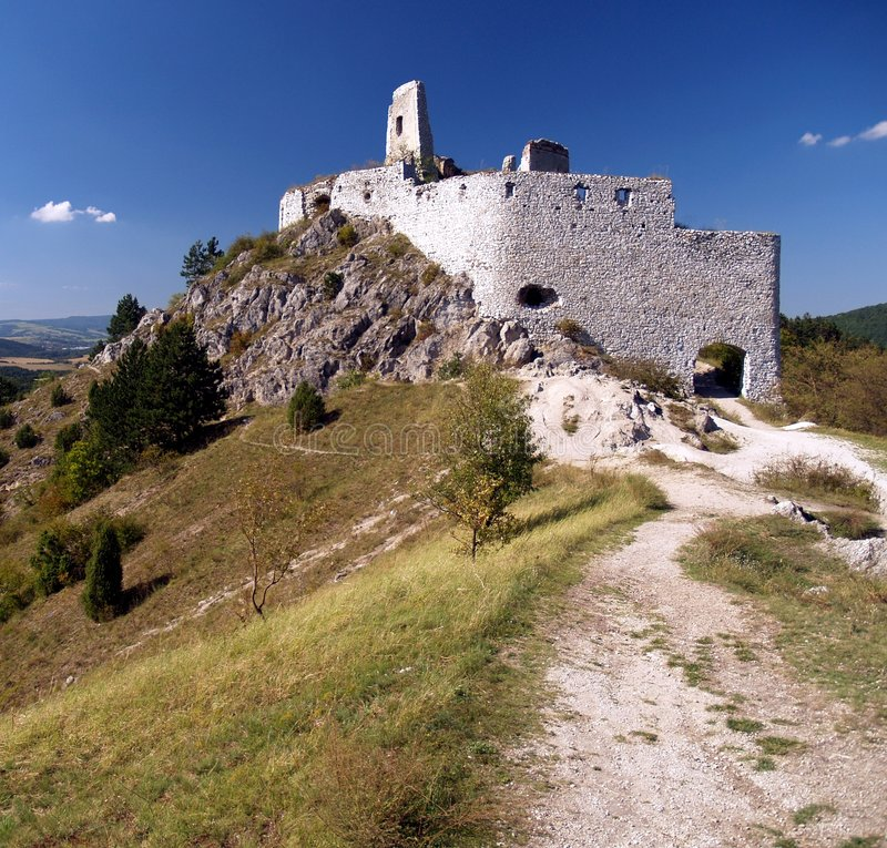 The Castle of Cachtice. A view of ruined Castle of Cachtice situated in the mountains above the Cachtice village in the west of Slovakia in Trencin region. The royalty free stock images