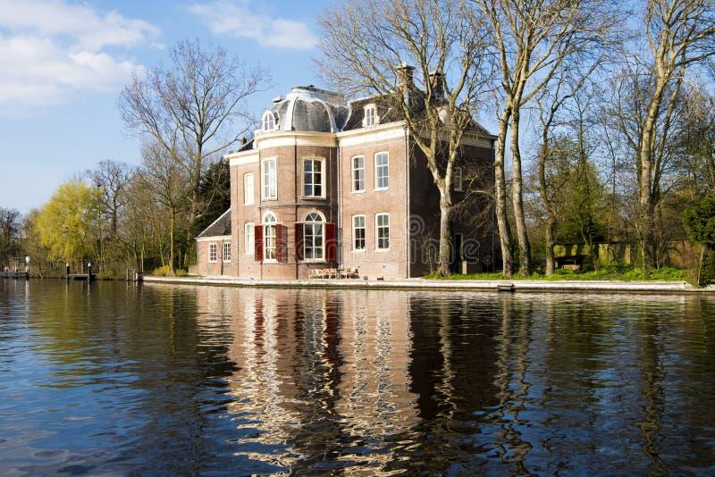 Castle on Canal Olde Rijn, Leiden, Netherlands. Beautiful castle on canal Olde Rijn, Leiden royalty free stock image