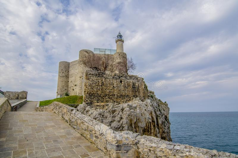 Castle of Santa Ana of Castro Urdiales. Castle of Castro Urdiales in province of Cantabria the nort of Spain on cloudy day royalty free stock image