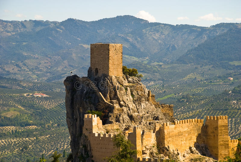 The castle of Cazorla in Andalusia, Spain. Against a landscape of olive trees stock photography