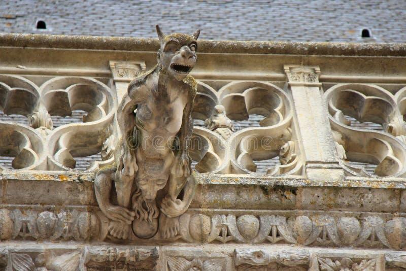 The castle of Châteaudun - France. A gargoyle decorates the facade of the medieval castle of Châteaudun (France). Une gargouille décore la façade du stock images