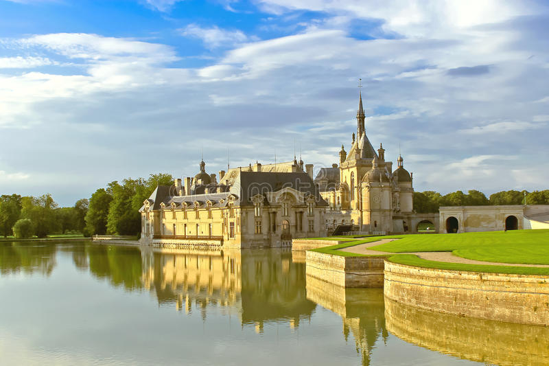 Castle of Chantilly at sunset. stock photo