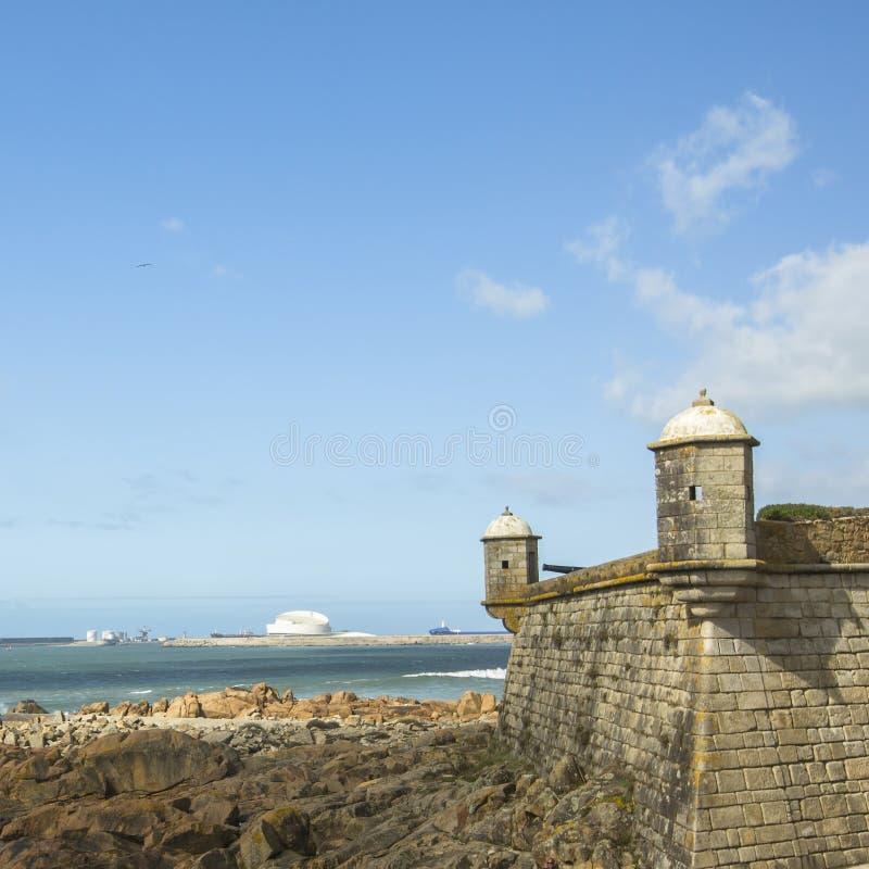 Castle of the Cheese (Matosinhos Castelo do Queijo) and surf at rocky Atlantic ocean coast in Porto stock photos