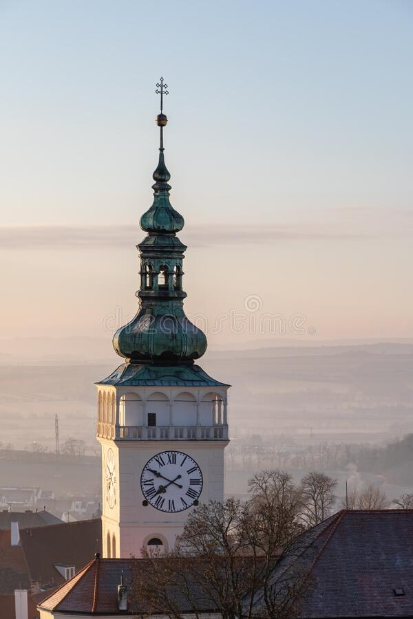Castle clock tower at sunny dawn stock photography