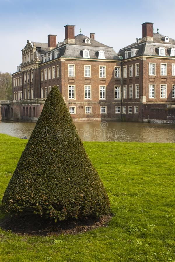 Castle and coned tree stock photo