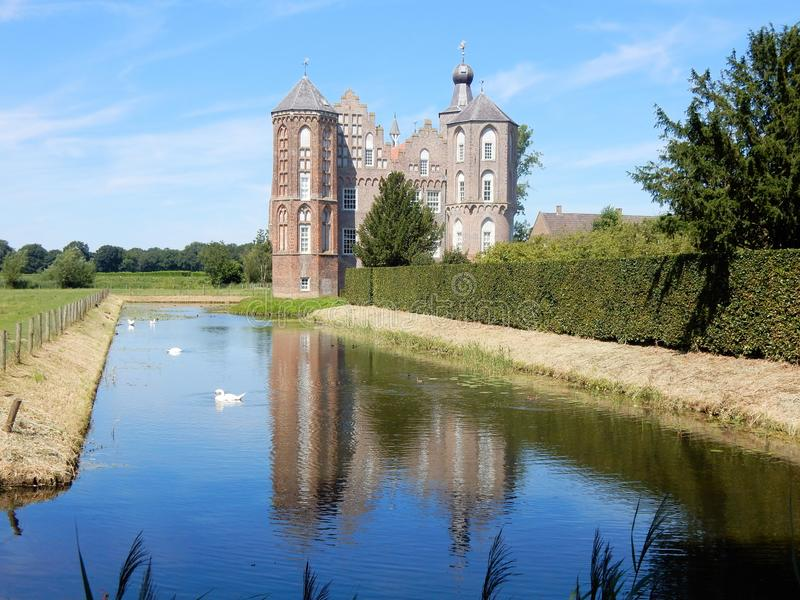 Dutch Castle Croy, Mansion with moat, Aarle-Rixtel, Laarbeek, Netherland. Dutch Castle Croy reflective in water, Mansion with towers and moat, Aarle-Rixtel royalty free stock images