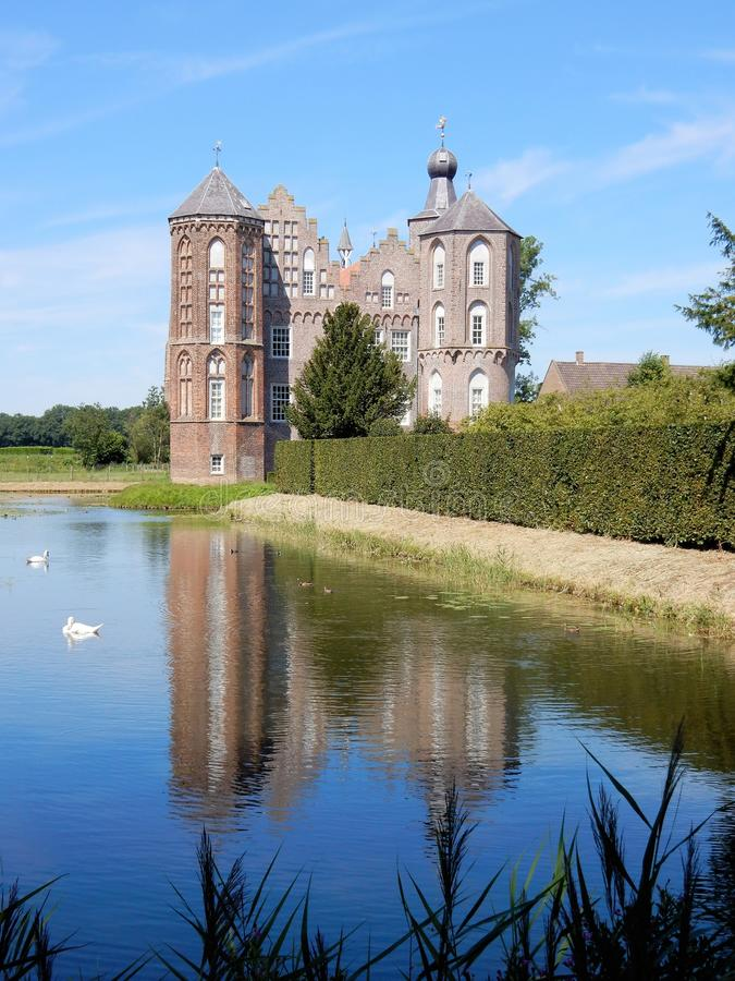 Dutch Castle Croy, Mansion with moat, Aarle-Rixtel, Laarbeek, Netherland. Castle Croy reflective in water, Mansion with towers and moat, Aarle-Rixtel, Laarbeek royalty free stock image