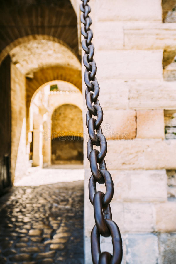 Castle door in Ibiza. With chains royalty free stock images
