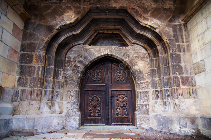 Castle door. Photo of a beautiful carved wooden castle door royalty free stock images