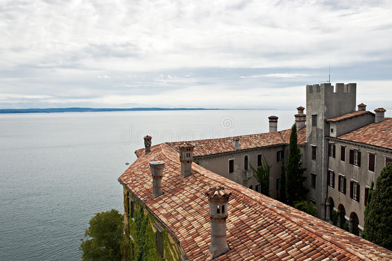 The castle of Duino and view of Gulf of Trieste. Italy royalty free stock images