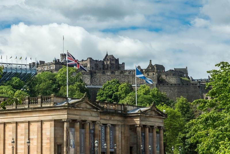 Castle of Edinburgh towers over Scottish National Gallery, Scotland UK. royalty free stock image