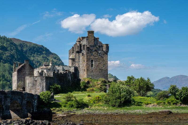 Castle Eilan Donan in the Scottish Highlands. Eilan Donan castle in the Scottish Highlands wit a nice blue sky and hills in the backgrounds stock photo