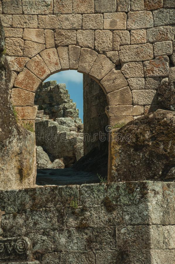 Castle facade with open gateway on stone wall royalty free stock images