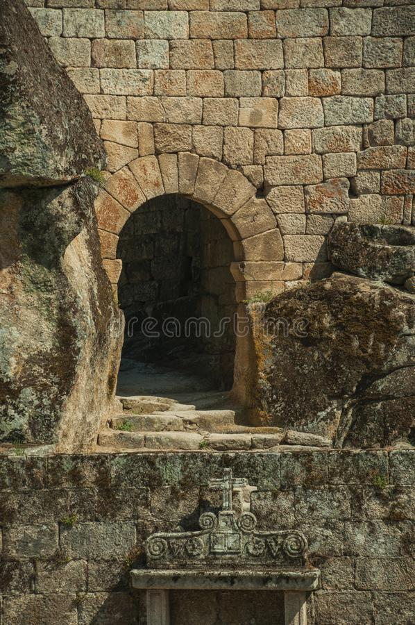 Castle facade with open gateway on stone wall royalty free stock photo