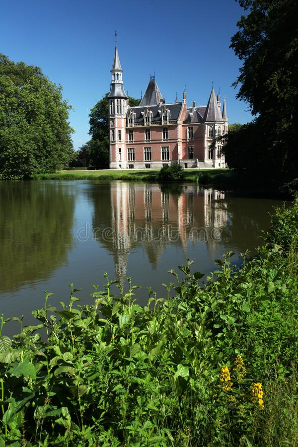 Castle garden lake belgium. Castle garden and lake in the city of Torhout in Belgium Aertrycke castle royalty free stock photo