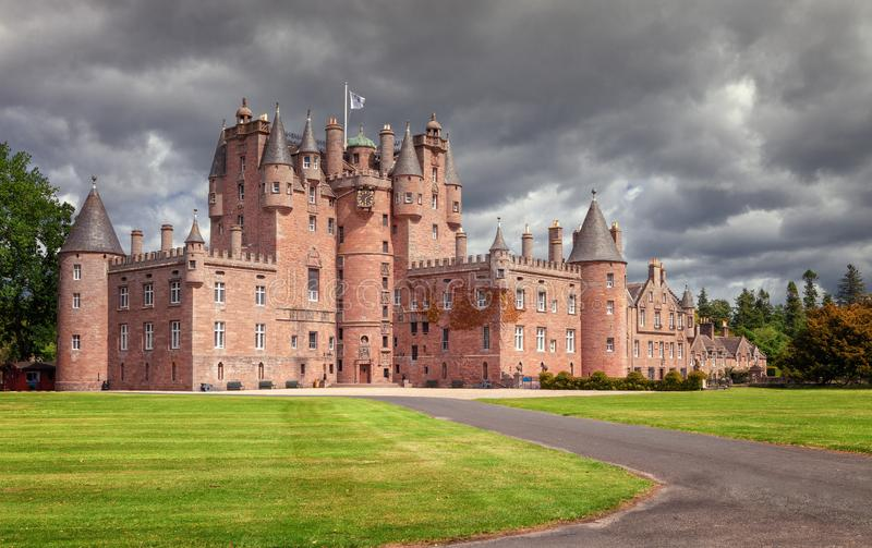 The Castle of Glamis is the typical Scottish castle, stately, full of turrets and battlements, was the legendary stage. Of Shakespeare`s Macbeth and is open to stock image