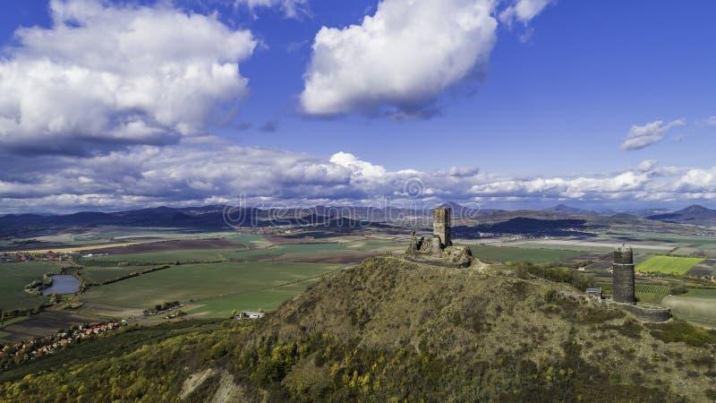 Castle Hazmburk. Ruines of Hazmburk castle on top of mountain peak of Ceske Stredohori range.  Medieval castle with views on czech stock photo