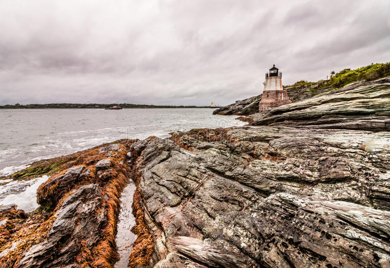 Castle Hill Lighthouse in Newport, Rhode Island, situated on a dramatic rocky coastline royalty free stock photography