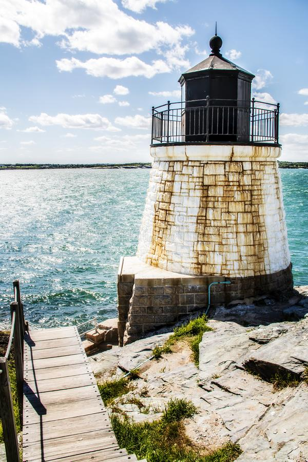 Castle hill lighthouse by the ocean in Newport Rhode Island stock photo
