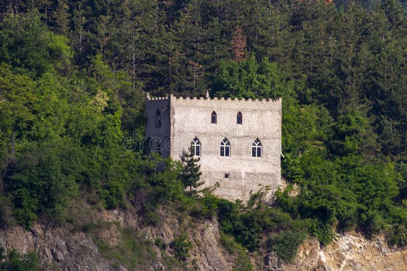 Castle on shores in Iron Gare. Castle on hillside cruising through the Iron Gate gorges on the Danube River between Serbia and Romania royalty free stock images