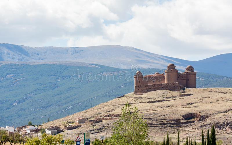 Castle on hilltop above La Calahorra Spain. Well preserved castle with four round towers above La Calahorra, Andalucia, Spain royalty free stock photo