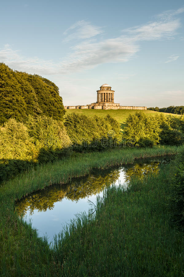Castle Howard - Mausoleum - York - North Yorkshire - UK. Castle Howard mausoleum seen from a bridge ovelooking a small lake stock photos