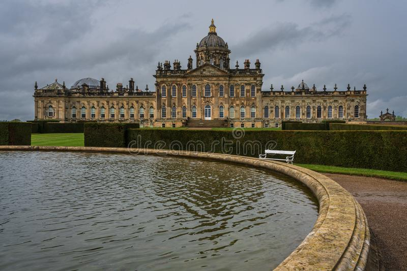 Part of the fountain and the gardens of Castle Howard, with the. Castle Howard, North Yorkshire, United Kingdom - May 7, 2019 :  Part of the fountain and the royalty free stock images