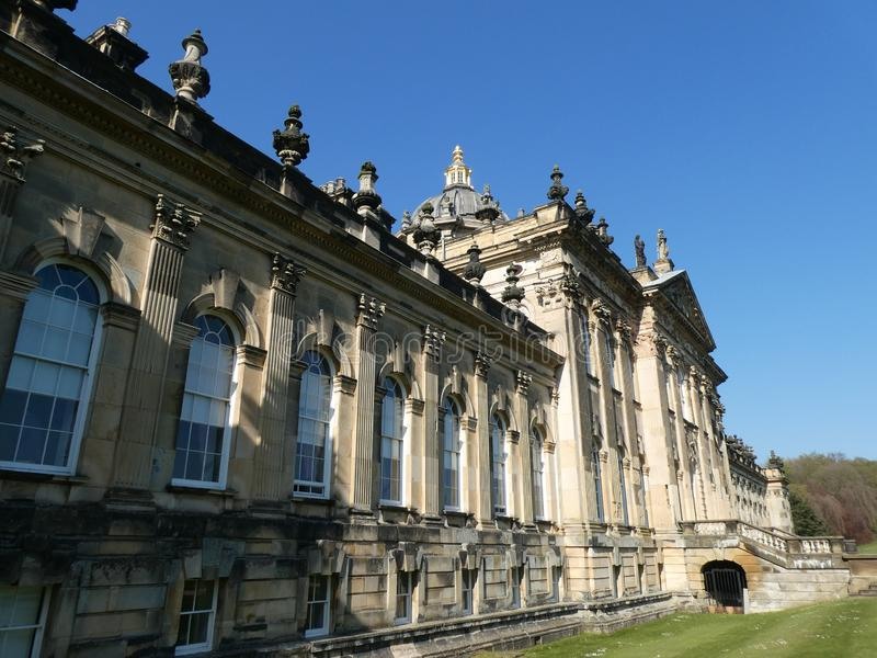 Castle Howard in the sun. Castle Howard on a warm April day. With the sun on it, highlighting the Architecture royalty free stock image