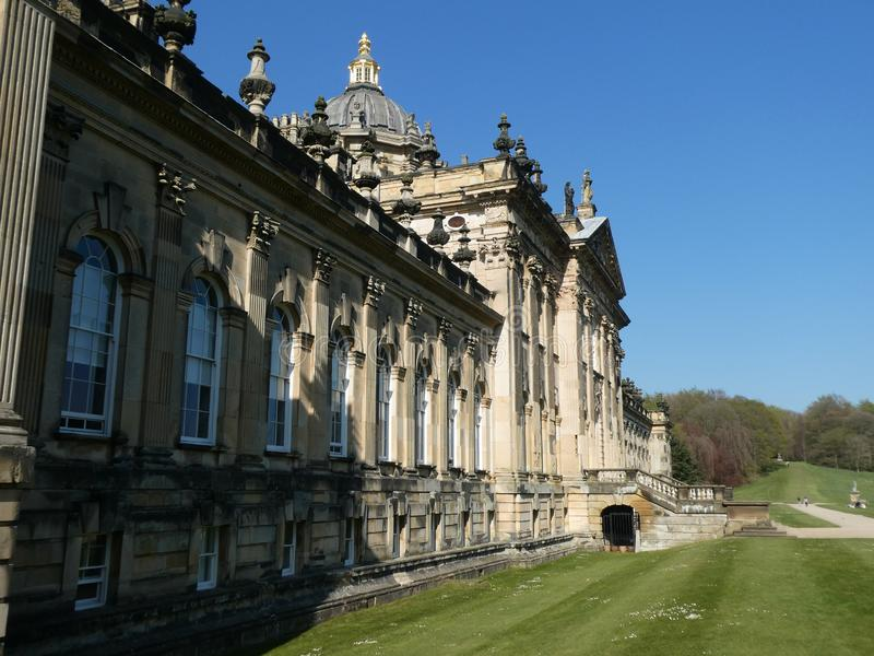 Castle Howard in the sun. Castle Howard on a warm April day. With the sun on it, highlighting the Architecture royalty free stock images