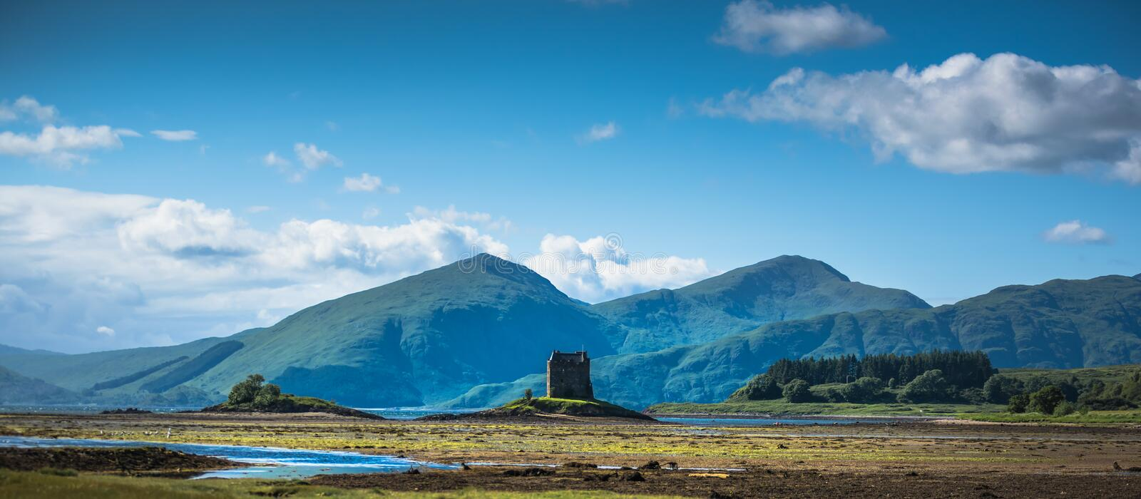 Castle on island - Castle Stalker - a picturesque castle surrounded by water located 25 miles north of Oban on the west coast. Of Scotland royalty free stock images