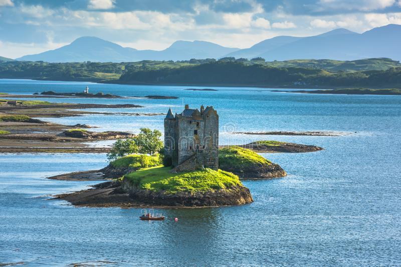 Castle on island - Castle Stalker - a picturesque castle surrounded by water located 25 miles north of Oban on the west coast. Of Scotland royalty free stock image