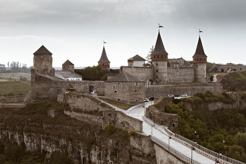 Castle in Kamianets-Podilskyi, Ukraine. Medieval stone large castle fortress with spiers and defensive towers stock image
