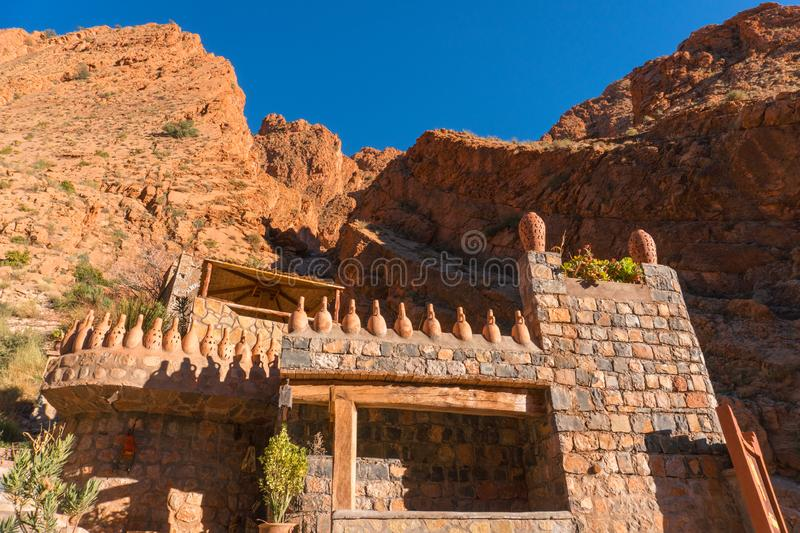 Castle kasbah hotel on the high Cliff in amazing place at Picturesque Serpentine mountain road in Gorges Dades in high. Atlas, Morocco stock photography