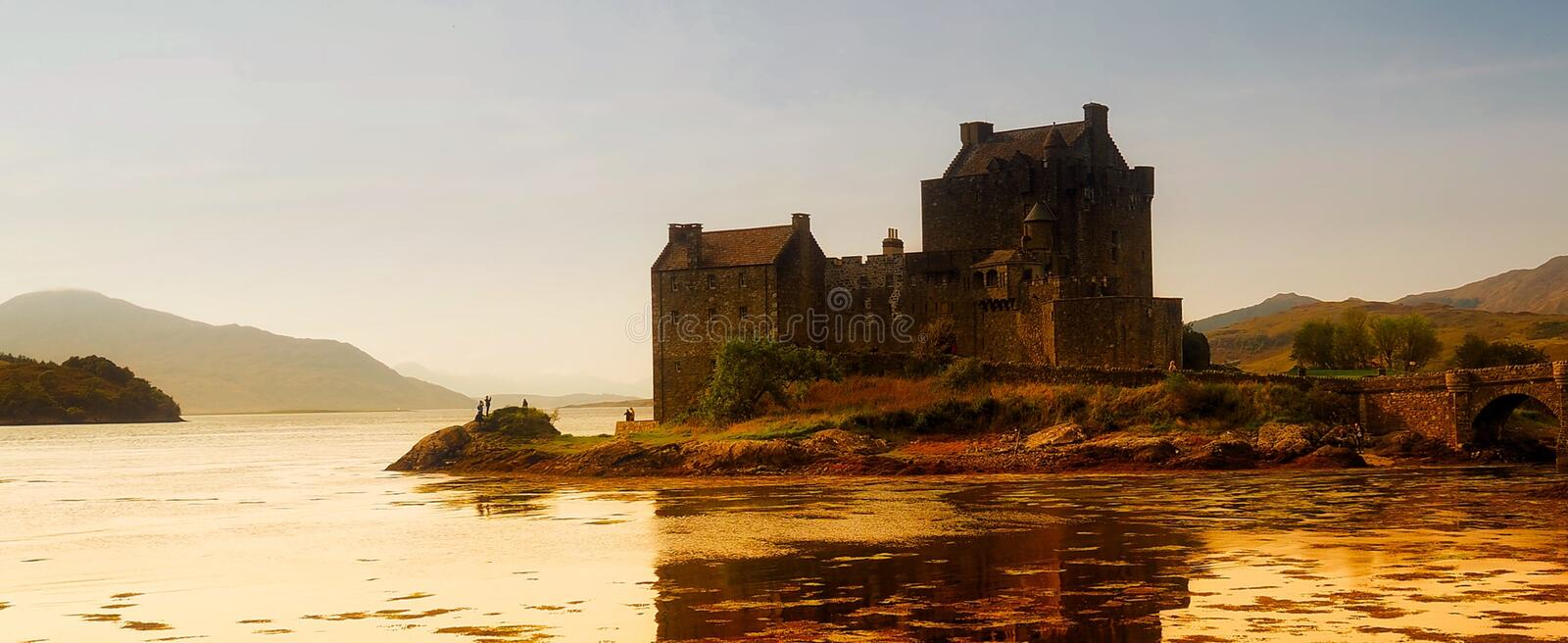 Castle on lakefront at dusk royalty free stock image