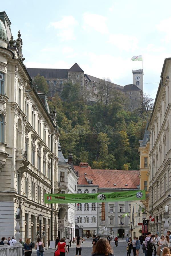 Castle Ljubljana. Ljubljana, Slovenia - October 13, 2014: Old Castle at Top of Hill and Pedestrians in Town Ljubljana, Slovenia royalty free stock image