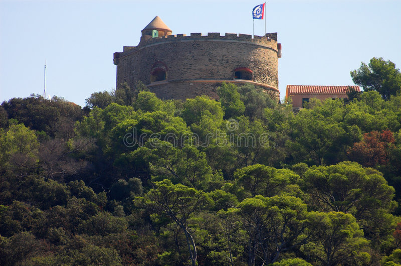 Castle with loopholes in the forest stock photography